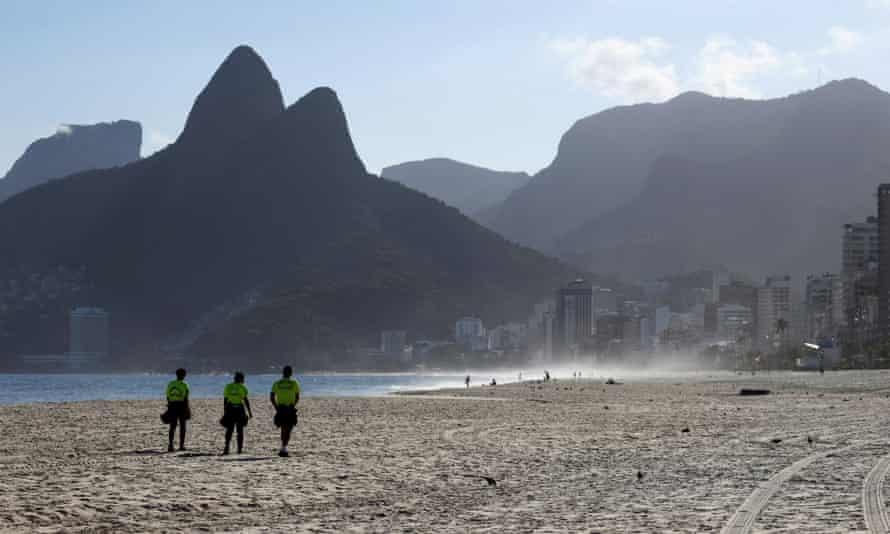 Police officers patrol Ipanema beach, amid the coronavirus lockdown