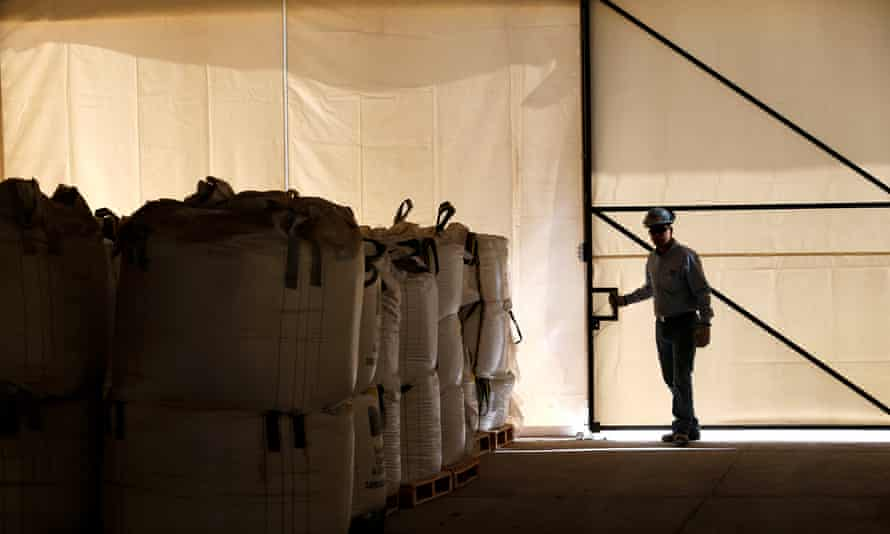 A worker closes a warehouse of lithium carbonate processed from the Rockwood Lithium mine.
