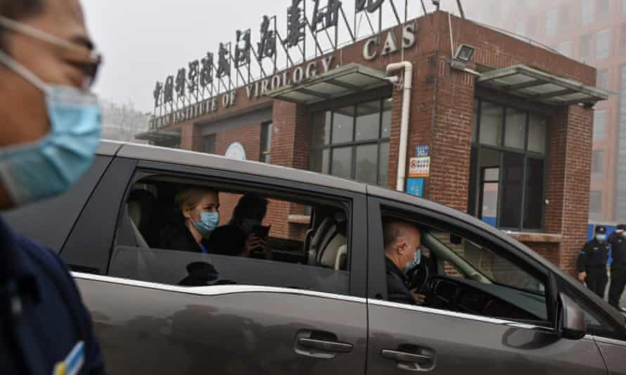 A WHO team investigating the origins of Covid-19 arrive at the Wuhan Institute of Virology in February 2021.
