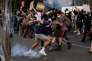 A tear gas canister lands at the feet of protestors near the White House.