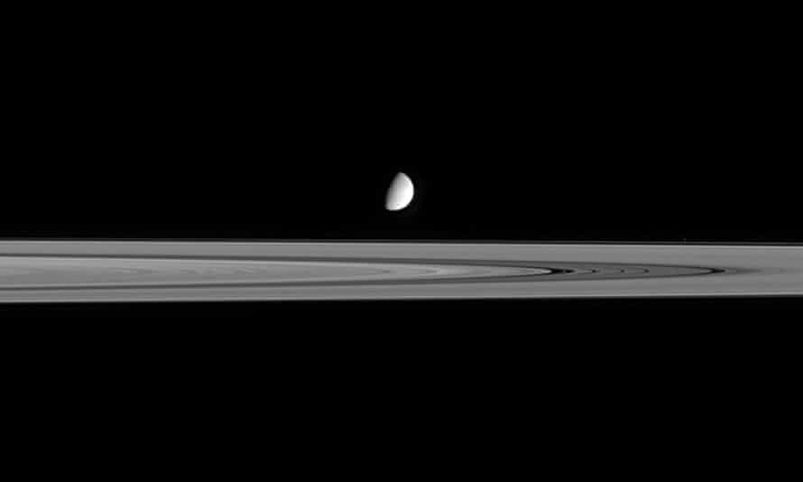Dark journeys into space … Saturn's B Ring and moon Enceladus.