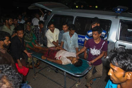 An injured Bangladeshi man is carried on a stretcher at Chittagong hospital after police opened fire during protests against a Chinese coal-fired power plant.