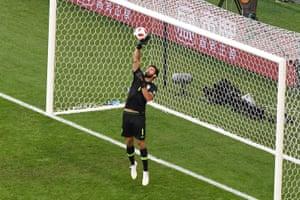 Brazil's goalkeeper Alisson gets a good hand onto Vela's shot.