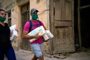 A Cuban couple carry packages of diapers as they walk in Old Havana, on 1 August, 2020, in Havana, Cuba. Cuba has announced that international flights with unrestricted movement of travelers within the country will only be allowed in phase three of Cubas reopening program. Havana is still in phase one. As Cuba fights the outbreak of the pandemic, the Ministry of Health has confirmed 25 new infections for yesterday for a total of 2633 infection cases and 87 deaths of Covid-19.