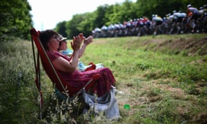 Fans applaud cyclists passing during the seventh stage between Belfort and Chalon-sur-Saone.