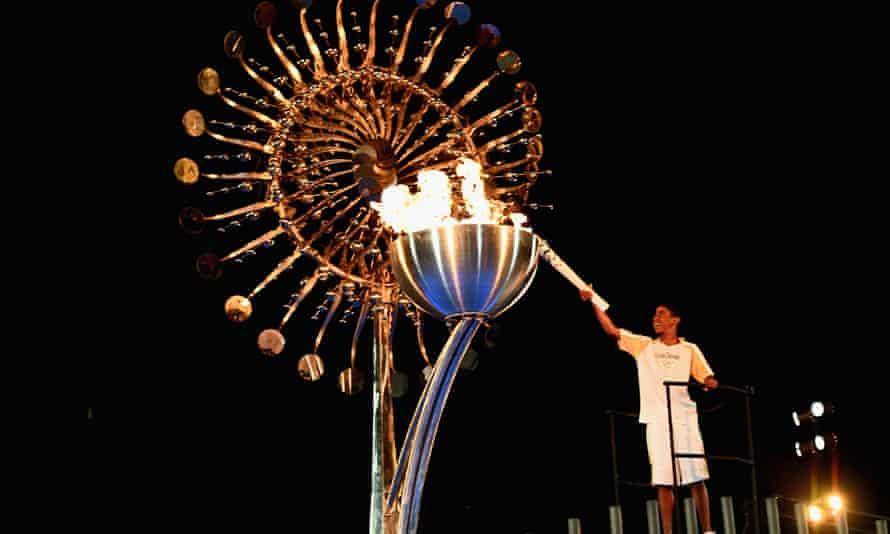 Lighting the Olympic cauldron.