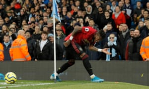 Manchester City's Fred is hit by missiles as he tries to take a corner during the Manchester derby.