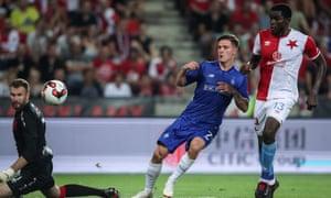 Dynamo Kiev's Benjamin Verbic (C) scores over Slavia Prague's goalkeeper Ondrej Kolar during the first leg of their Champions League qualifier.
