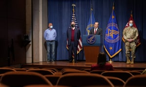 Health and human services secretary, Alex Azar, (second from right), speaks during a news conference on Covid-19 vaccine distribution on Tuesday.