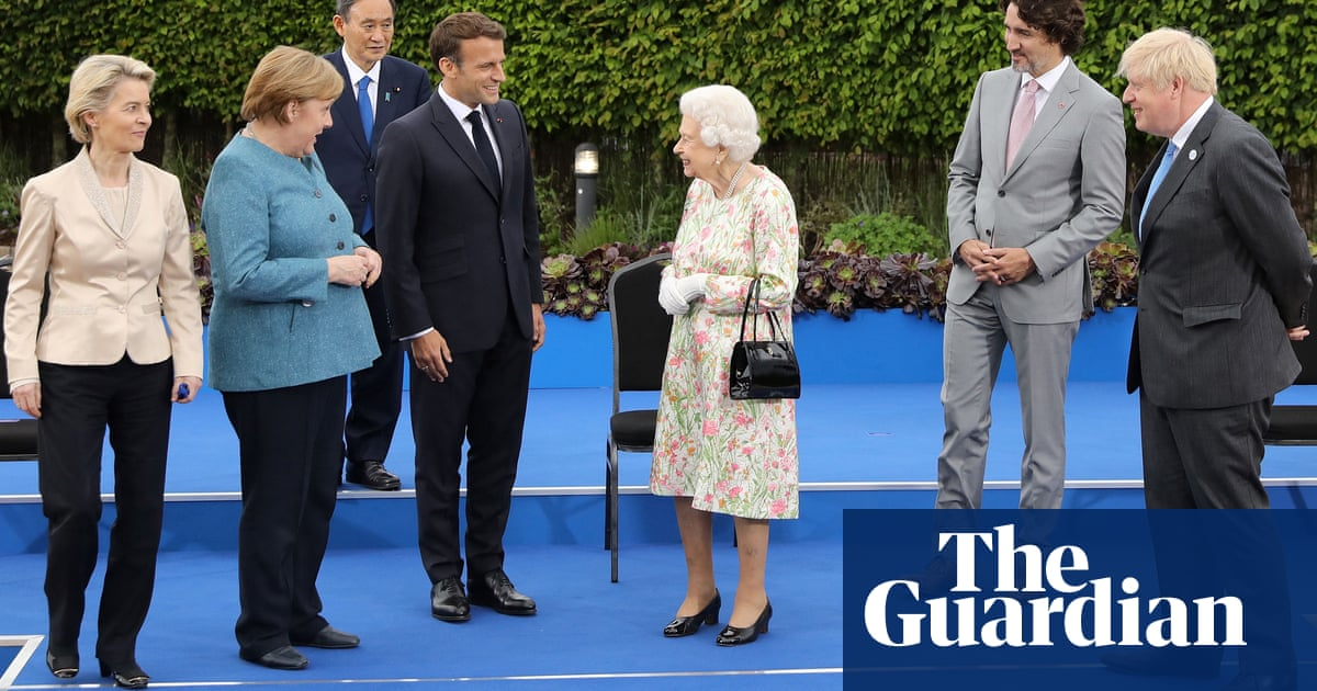 'Enjoying yourself?': Queen jokes with G7 leaders in family photo – video