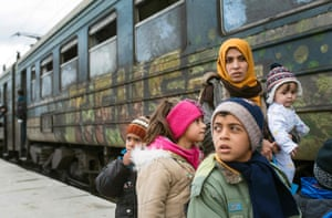 Refugees board a train heading to Serbia from the Macedonian-Greek border