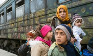 Syrian refugees board a train heading to Serbia from the Macedonian-Greek border in February 2016.