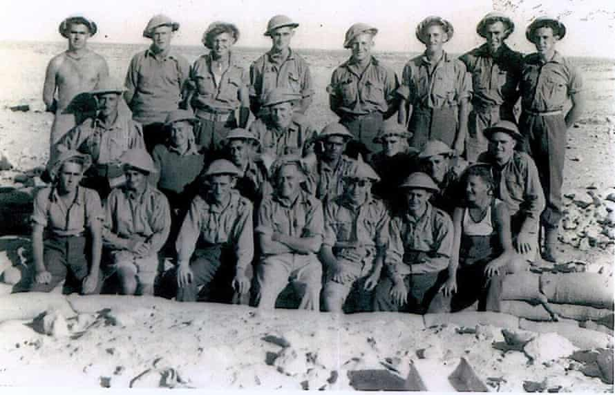 Stan Grant's grandfather Cecil Grant (middle row, fourth from right) with fellow troops in Tobruk, Egypt, during the second world war. Unlike the other men, Cecil Grant was not officially recognised as an Australian citizen.