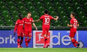 Mitchell Weiser celebrates with teammates after scoring the third for Leverkusen.