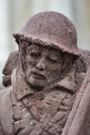 London, UKA sculpture made from sand and mud depicting a First World War soldier is on view in Trafalgar Square to commemorate the 100th anniversary of the battle of Passchendaele. Made by Belgian artist Damian Van Der Velden it will slowly dissolve by artificial rain in four days