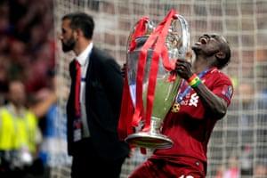 Sadio Mane of Liverpool celebrates with the trophy.