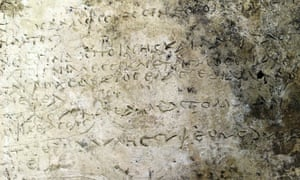 Clay plaque with an engraved inscription depicting 13 verses from the Odyssey's 14th Rhapsody, discovered in ancient Olympia, Greece.