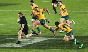 Dane Coles leaves the Wallabies in his wake.