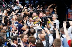 Mercedes' Lewis Hamilton celebrates his win with his team.