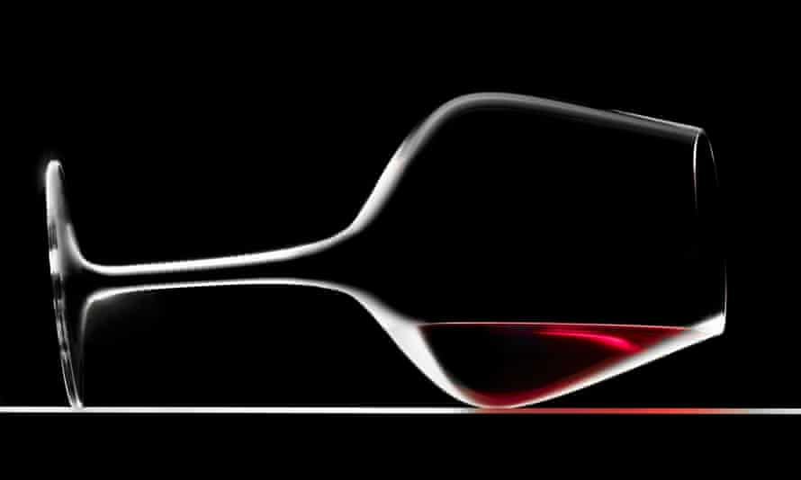 Glass of red wine on its side