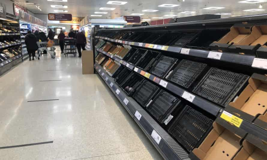 Empty shelves in Sainsbury's at the Forestside shopping centre in Belfast, as a result of rising trade problems.