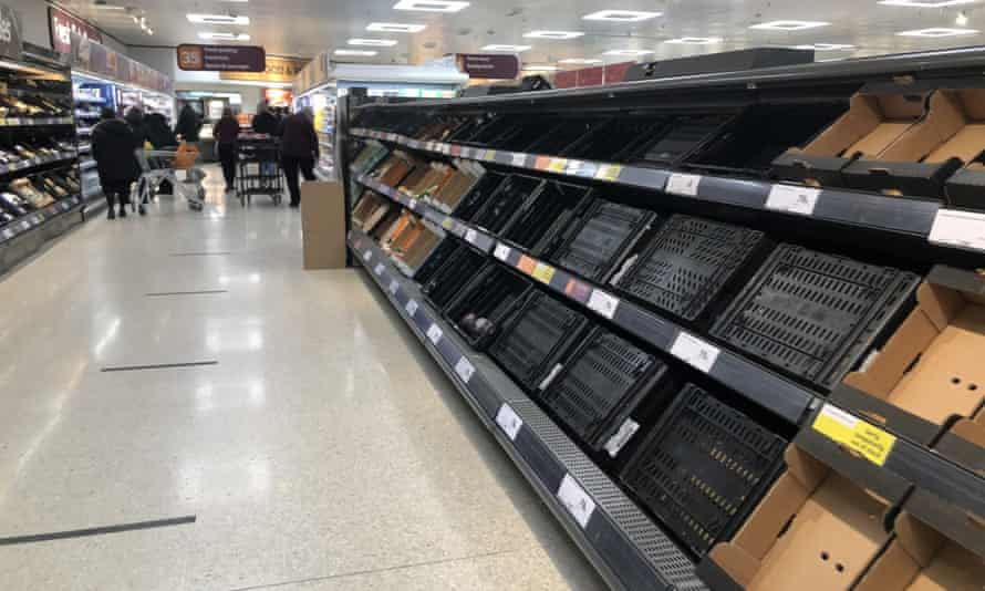 Depleted shelves in Sainsbury's at the Forestside shopping centre in Belfast, 11 January 2021.