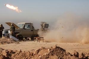 A Katyusha rocket launcher is fired by peshmerga troops