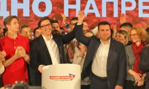 Stevo Pendarovski (second left) appears with prime minister, Zoran Zaev, after winning the run-off in North Macedonia's presidential election.