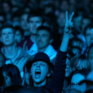A woman in the crowd cheers The Who at the Live 8 concert in Hyde Park, London, in 2005.