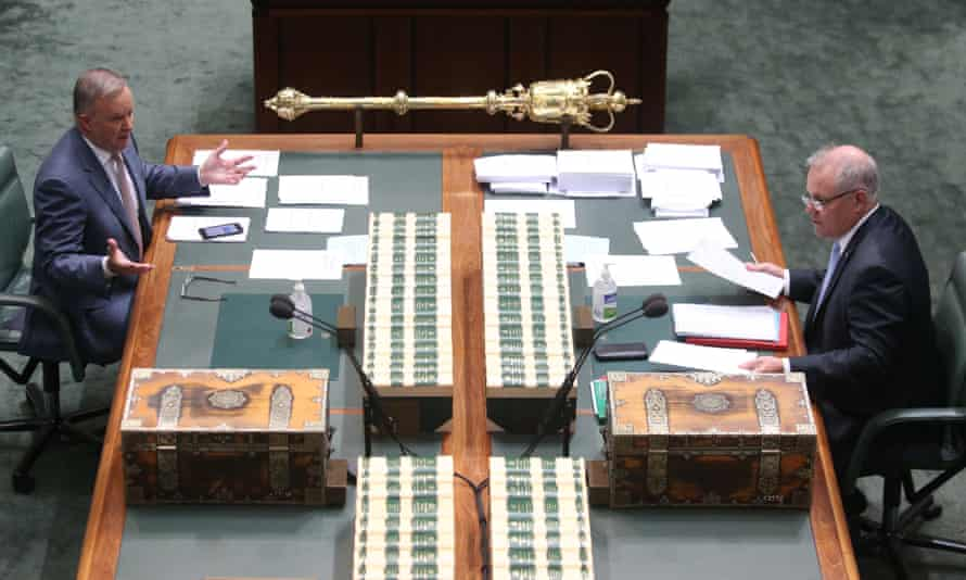 Australian prime minister Scott Morrison talks to Labor leader Anthony Albanese in parliament