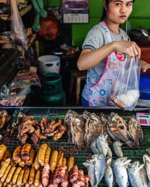 Sausages and fish on a stand at Sompet market, Chiang Mai, Thailand