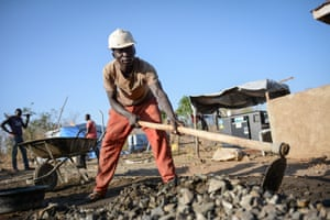 Patrik, 23, from Uganda is a construction worker paid to help build a motorised borehole for the camp and host community.