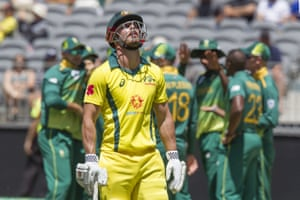 Australia's Chris Lynn (C) walks off after being dismissed during the first one-day international (ODI) cricket match between South Africa and Australia at the Optus Stadium in Perth.
