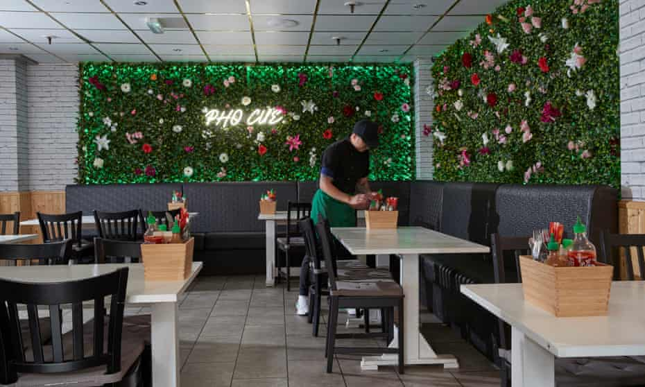 'The owner, Cue Tran, can say he merely used his own name, but he's savvier than that…' the dining room and vertical garden at Pho Cue.