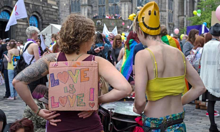 People take part in the annual Pride Scotia parade in Edinburgh's old town to campaign for LGBTI rights.
