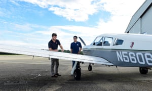 Davis Hughes, left, a student pilot with Trojan Aviation and senior at Troy University, goes through the pre-flight inspection with Trent Stewart.