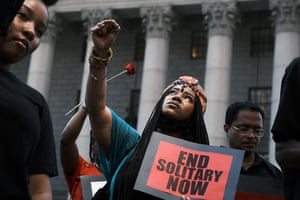 People participate in a protest in front of a courthouse to demand that Mayor Bill de Blasio put an end to solitary confinement in New York's prisons