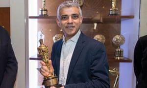 Sadiq Khan holds an Oscar awarded to the special effects company Double Negative during a visit to the firm in central London.