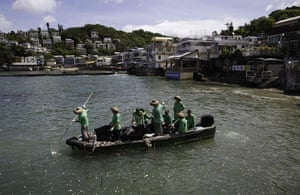 Hong Kong Contract clean-up workers for the Hong Kong Marine Department use nets from a boat to scoop lumps of solidified palm oil from the water. About 1,000 tonnes of the substance spilled from a cargo ship after a collision with another vessel, closing beaches in the area
