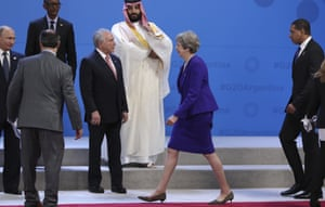 Mohammed bin Salman stands apart as Theresa May passes by