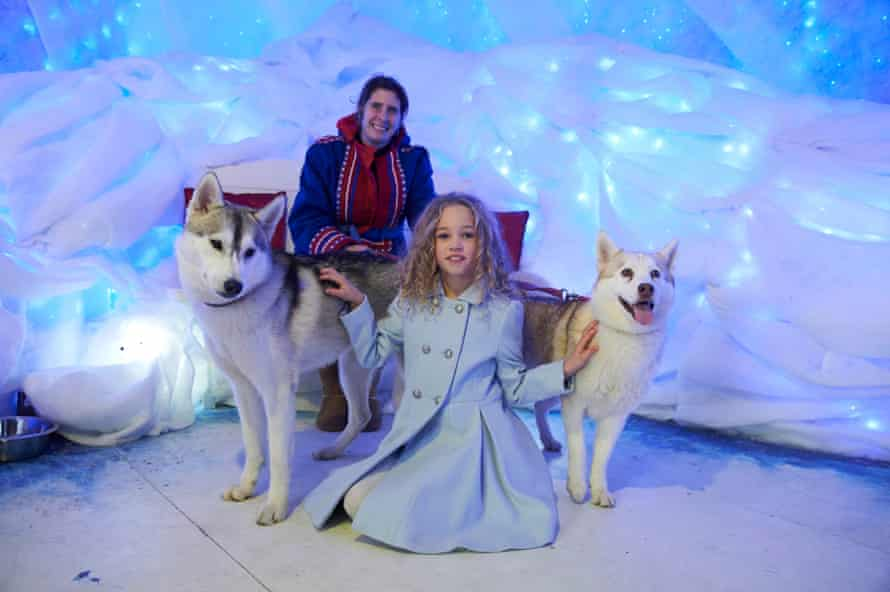 Girl with two huskies in the ice cave at Drusillas Park, Sussex