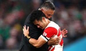 Kenki Fukuoka embraces his head coach, Jamie Joseph, after their World Cup quarter-final defeat.