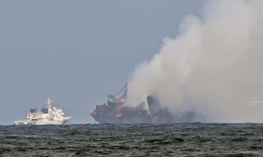 An Indian coastguard ship tries to douse the fire as smoke billows from MV X-Press Pearl