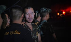 Military personnels, rescue workers and volunteers head out from Tham Luang.