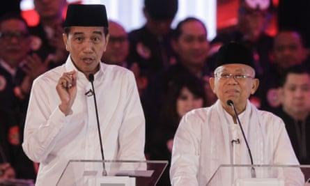 Indonesian president Joko Widodo, left, and running mate Ma'ruf Amin speak at the first televised debate in Jakarta on Thursday.