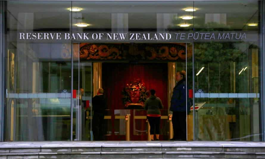 A security guard stands in the main entrance to the Reserve Bank of New Zealand in central Wellington