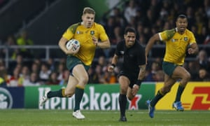 Drew Mitchell runs with the ball as Australia try to find a way back into the match.