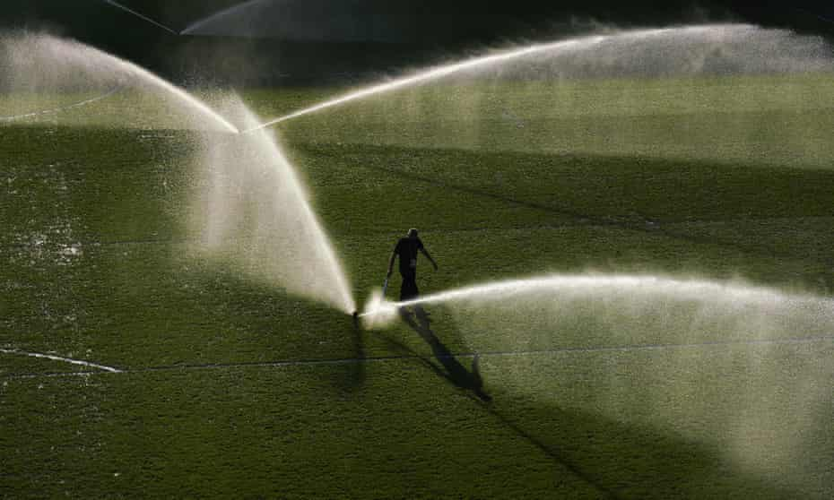Watering the pitch in Brentford, west London.