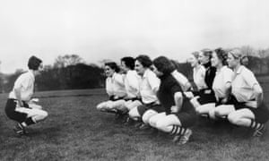 Miss Parr, captain of the Preston Ladies Football Club leads her team in their excercises. (Photo by Fox Photos/Hulton Archive/Getty Images)