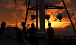 Crew members of the Alan Kurdi rescue ship prepare for a memorial service
